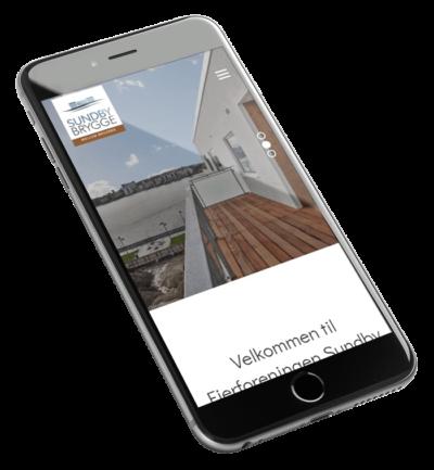 Sundby Brygge webdesign set fra mobil på skrå